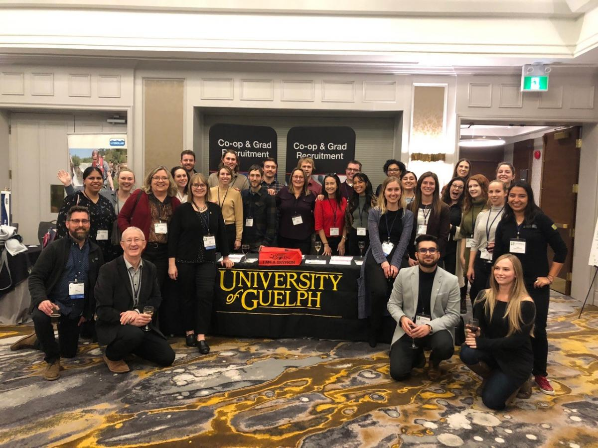 Students and faculty around UofG table at Latornell Conference
