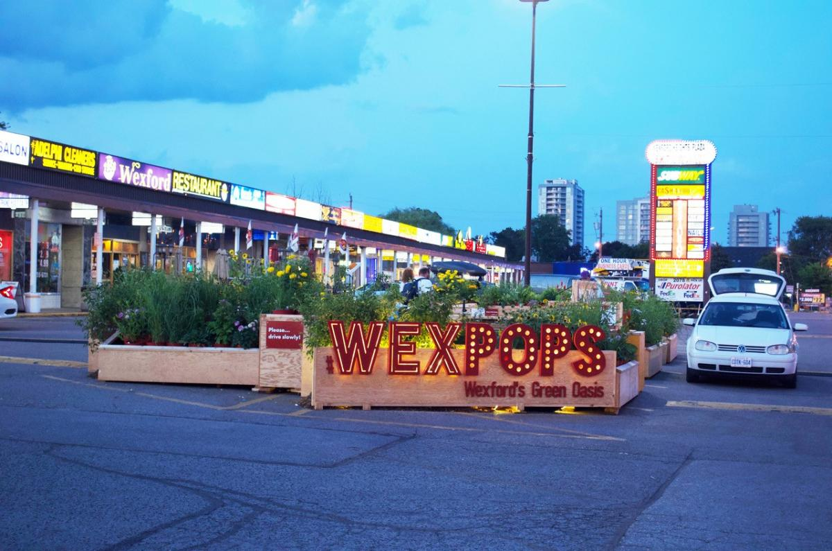 WexPops, pop-up parklet in parking lot plaza