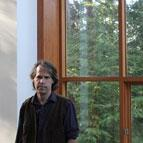James Tuer in front of large windows