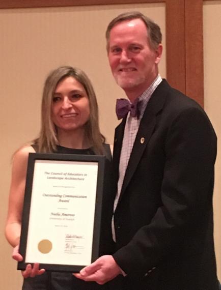 Nadia Amoroso receiving award from Mark Boyer