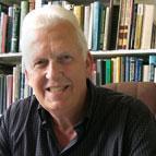 Patrick Mooney head shot in library