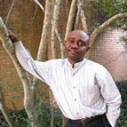Forester Ndubisi leaning on a tree