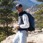 Randy Gimblett hiking on mountain
