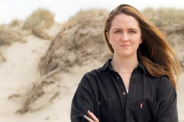 Zannah Matson standing in front of sand dunes