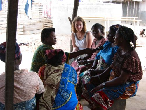 student meeting with African tribe