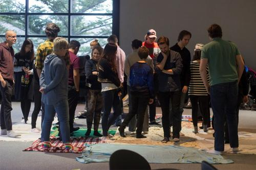 students participating in Kairos blanket exercise