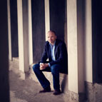 Andrew Anderson sitting against wall