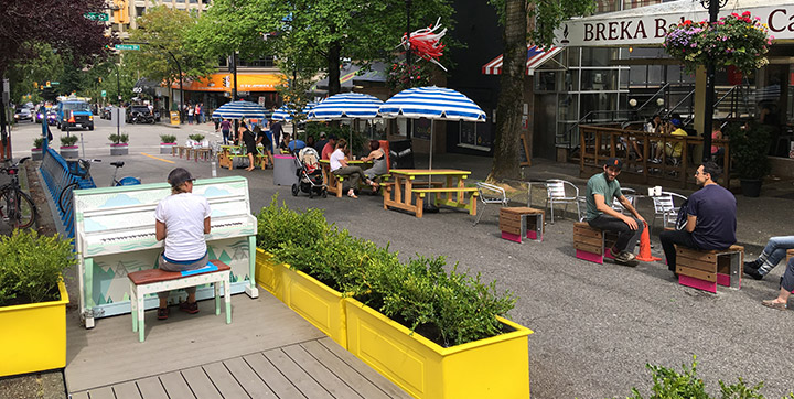 People using parklet space on city street