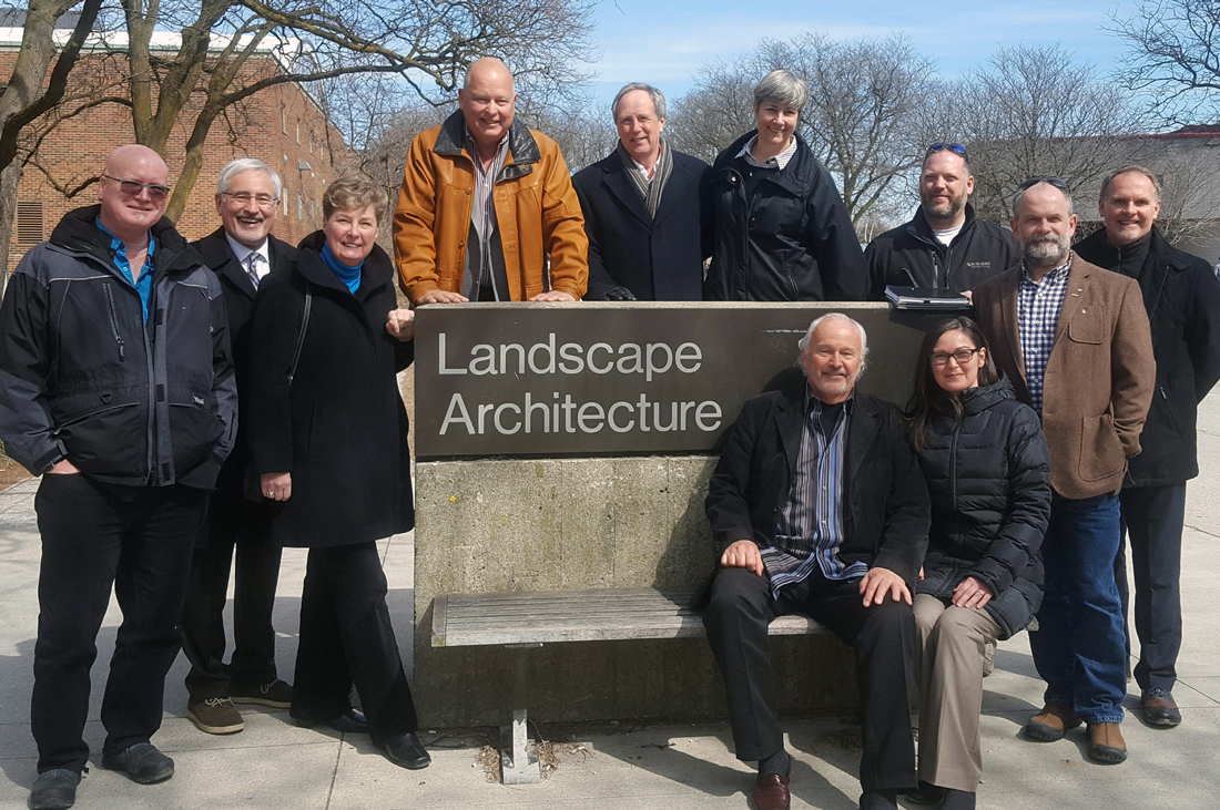 LAAA members stand outside with Landscape Architecture sign