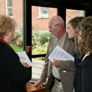 Mary Ferguson (left) sharing information to conference attendees