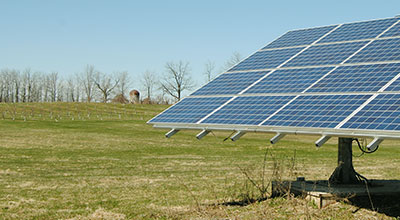 Farmers field with large solar panel