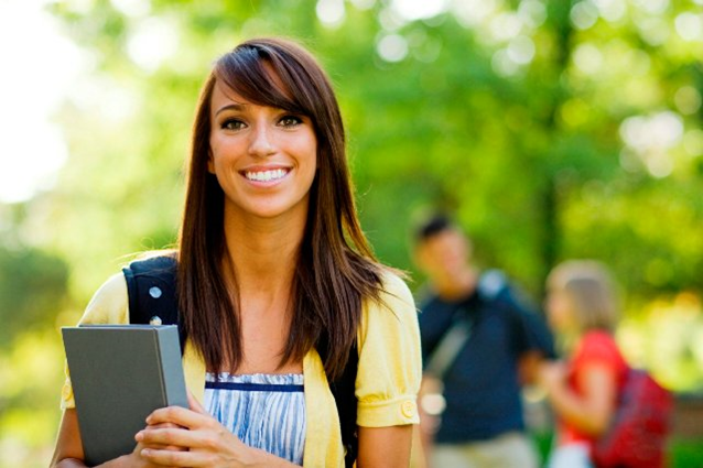Student standing and smiling