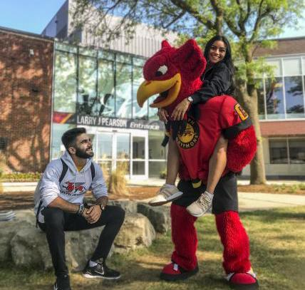 Gryphon mascot and students outside of Athletics Centre