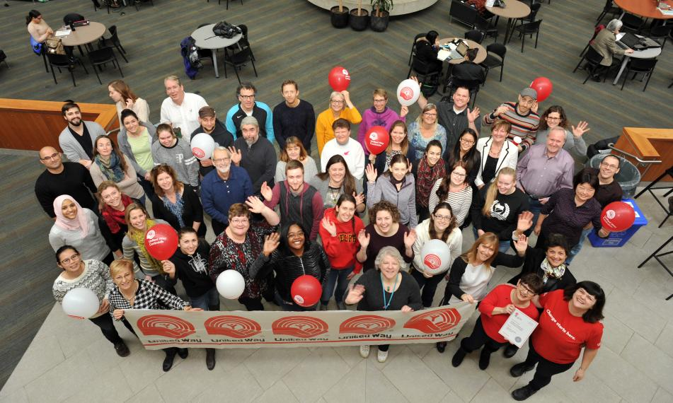 Aerial view of CBS volunteers with United Way banner.