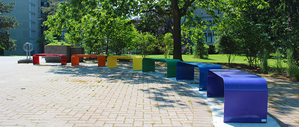 Rainbow benches on campus.