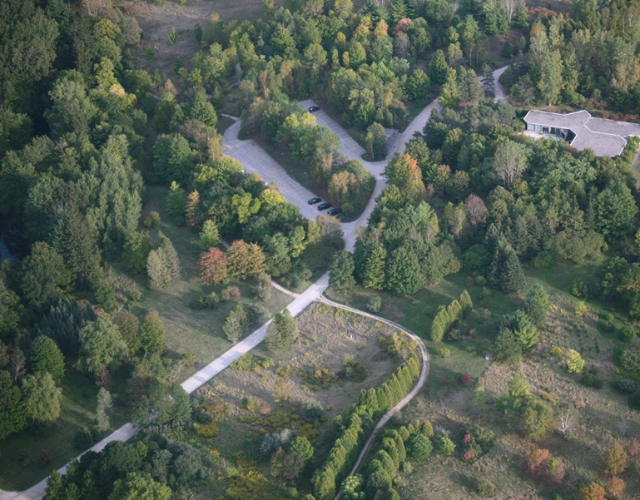 Arial view of the Arboretum at the University of Guelph in September. Mostly green trees, but some are beginning to change colour.